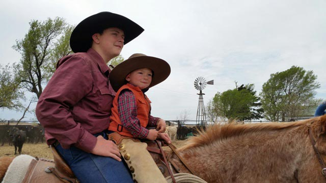 ow here's a cowboy team, Brayden Krepps with little brother Caleb on front during a spring ranch branding.