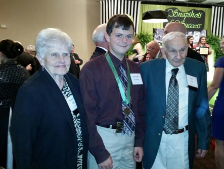 Brayden Krepps, Cambridge, was honored as the State 4-H Horse Award winner at the Emerald Circle Banquet and received congratulations from Don and Donna Kill, longtime sponsors of the award in Kansas.