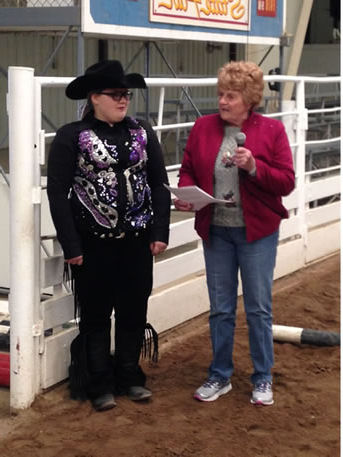 Helping others has been the life work of Karen Russell as she presents a scholarship to one of literally thousands and thousands she's helped from the classroom to the show pen.